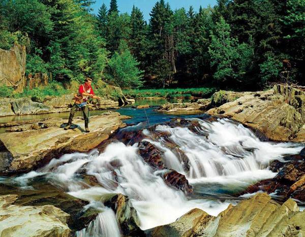 April 2016 - man fishing in rushing river