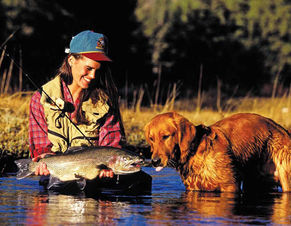 September 2016 - woman and dog with fish
